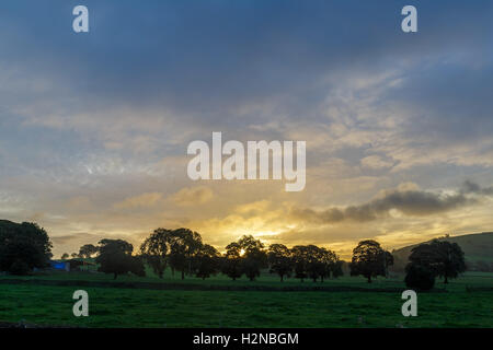 Sunrise over farm land. In Longnor, Staffordshire, England. - Stock Photo