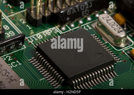 Electronic printed circuit board with components - Stock Photo