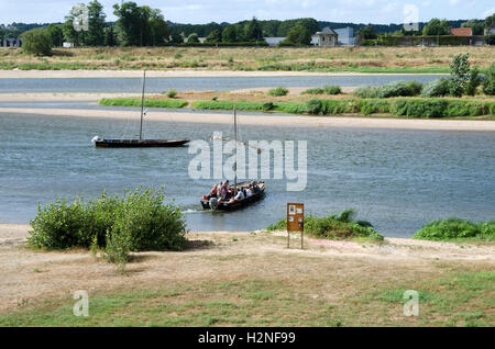 Amboise France - Passengers aboard a small tour boat on the River Loire - Stock Photo