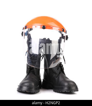 Hard hat and working boots. - Stock Photo