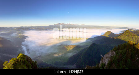 View from Three Crowns to The Tatra Mountains. Morning landscape. Poland. Panorama - Stock Photo