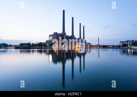 View of the old Volkswagen factory buildings at dusk. Wolfsburg, Germany - Stock Photo