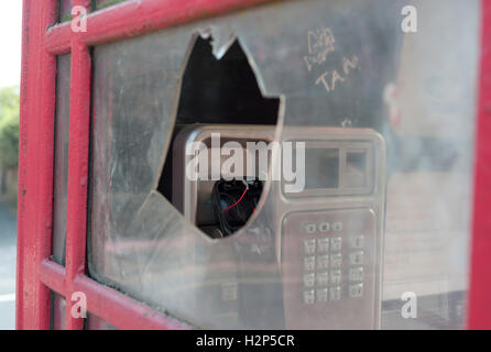 Vandalized telephone box. - Stock Photo