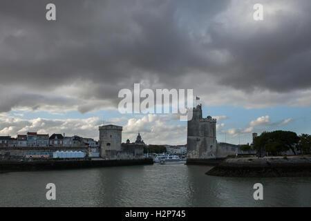 Tour Saint-Nicolas (R) and Tour de la Chaine (L) in the Old Harbour (Vieux Port) in La Rochelle, France. - Stock Photo