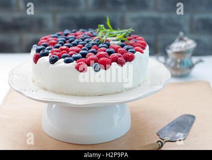 Cheesecake, cream mousse cake with fresh berries - Stock Photo