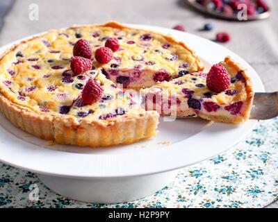 Raspberry, blueberry and white chocolate tart - Stock Photo