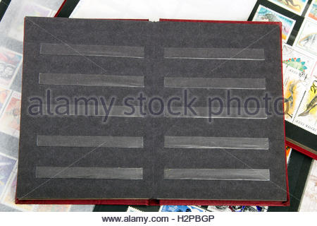 stamp album with colorful stamps - Stock Photo