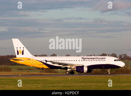 G-OZBK Monarch Airlines Airbus A320-214 taxing at London Luton airport. 17th December 2006. - Stock Photo