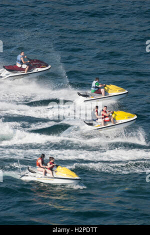 ACAPULCO, MEXICO - FEBRUARY 19, 2006 : Tourists riding on four jet skis in the bay of Acapulco, Mexico. - Stock Photo
