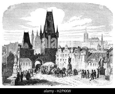 19th Century view of one of the bridge towers of the Charles Bridge in over the Vltava River in  Prague, the capital - Stock Photo