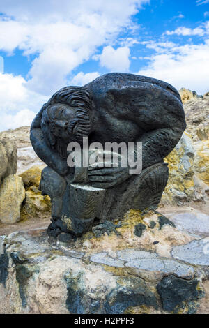 Statue made of volcanic rock on the Island of Vulcano, Italy - Stock Photo