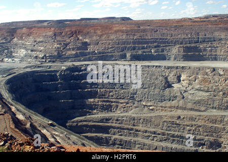 View inside the huge hole and big machines of the gold mine in Kalgoorlie in Western Australia - Stock Photo
