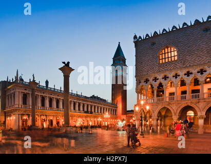 Doges palace, Campanile bell tower and Venice republic coat of arms lion on tall column at San Marco square at sunset - Stock Photo