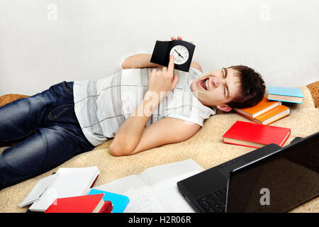 Tired Student on Sofa - Stock Photo