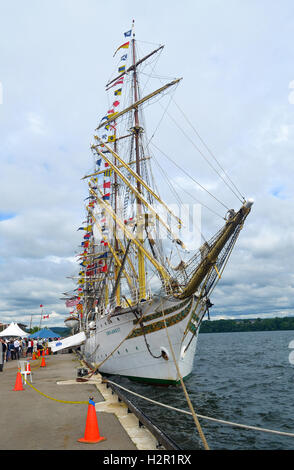 A big tree mast tall ship under blue sky in the harbor of Hamilton, Ontario, Canada. - Stock Photo