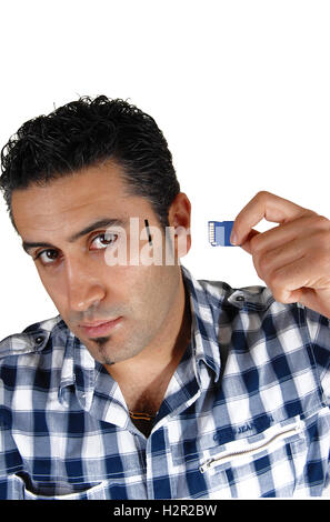 A close up picture of a young man try to put more memory in his brain, for white background. - Stock Photo