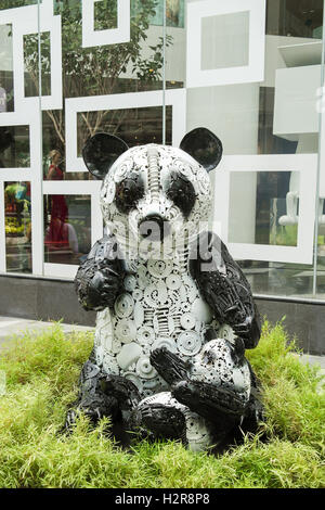 Panda bear steel statue in front of a shopping mall in Bangkok - Thailand - Stock Photo