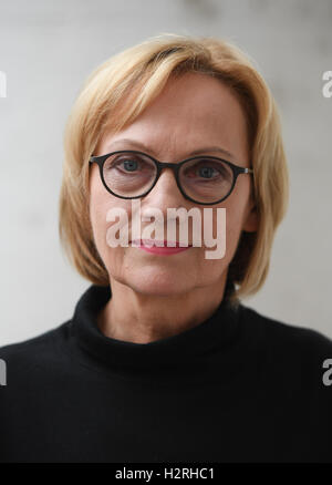 Author Eva Schmidt looks into the camera during a reading at the Stock Photo, Royalty Free Image ...