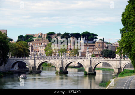 View from the Ponte S Angelo, westwards to the Vittorio Emanuele bridge and the Janiculum hill - Stock Photo