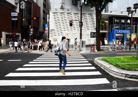 Japanese people and traveler foreigner walking cross over road at crosswalk go to Dotonbori on July 7, 2015 in Osaka, - Stock Photo