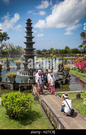Indonesia, Bali, Tirta Gangga, Ababi, Palace, local tourists wearing traditional costume in water garden