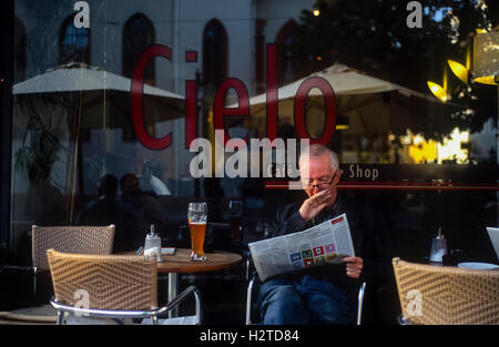 Man yawning outside a cafe Durlach Karlsruhe Baden-Württemberg Germany - Stock Photo