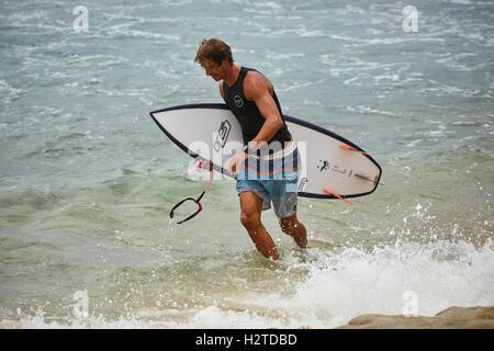 Barbados atlantic coast Bathsheba rocks   pretty Young male boy man surfing surfers copyspace surfboards waiting - Stock Photo