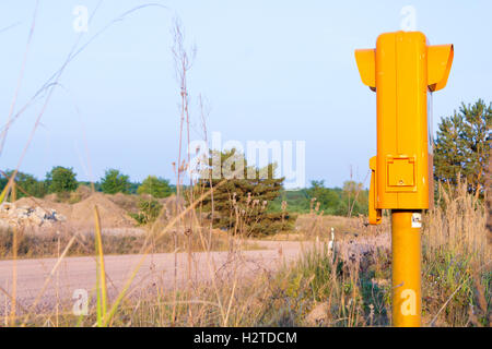 german sos call box on an empty road - Stock Photo