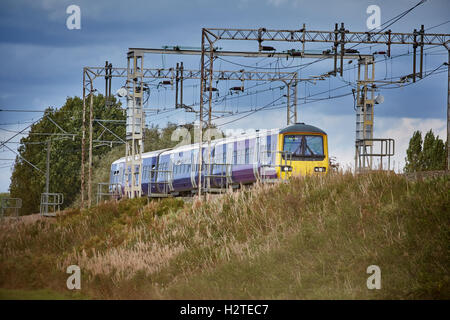 Northern train unit railway service   Adlington Manchester to Macclesfield line Transport transporter transportation - Stock Photo