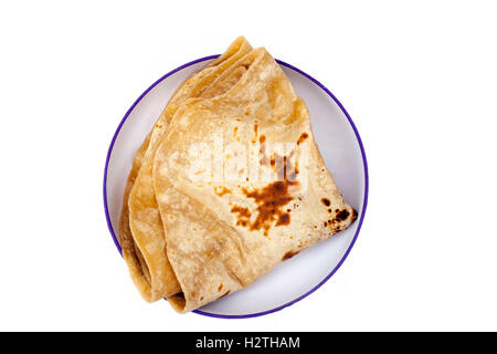 Indian Roti on traditional Indian Plate, isolated on white. - Stock Photo