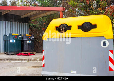 Containers of oil and plastic for waste separation, recycling center - Stock Photo