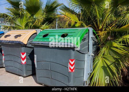 Containers of plastic and glass for waste separation,recycling center - Stock Photo