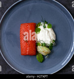 Cured sea trout with horseradish cream, cucumber chutney and micro herbs - Stock Photo