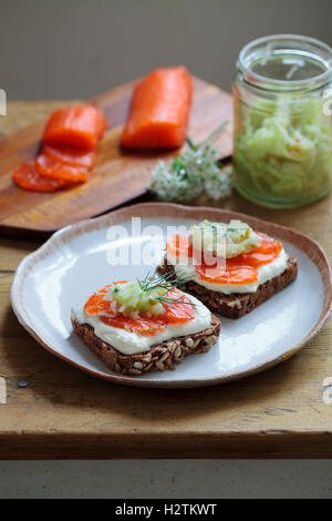 Scandinavian dark bread with cured trout , micro herbs, cucumber chutney and horseradish cream - Stock Photo