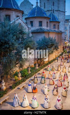 Flower offering parade,People with Floral tributes to `Virgen de los desamparados´, Fallas festival,carrer del Micalet - Stock Photo