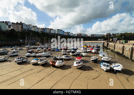 View of Tenby Harbour with fishing boats lined up awaiting the incoming tide, Pembrokeshire, Wales, - Stock Photo