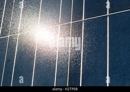 Solar energy production. Photovoltaic module with Sun reflection. - Stock Photo
