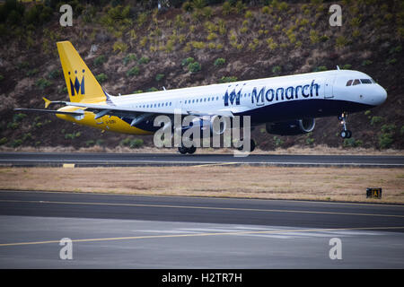 Monarch A321-231 airplane landing at Funchal airport, Maderia - Stock Photo