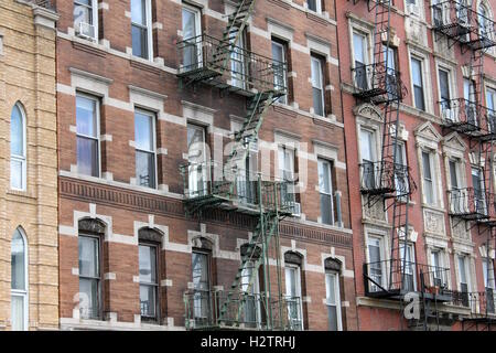 Brick Apartment Building Window old vintage apartment buildings with wall of windows and water