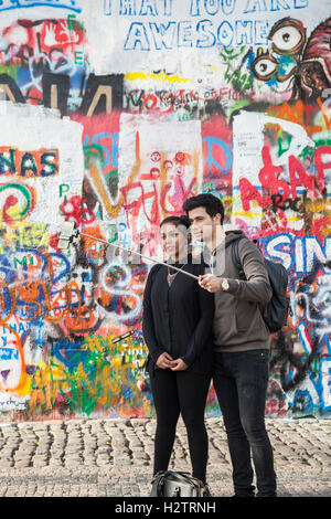 John Lennon wall in Prague. After his murder in 1980 it was a political graffiti protest by the young Czech - Stock Photo
