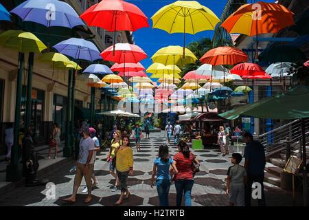 Caudan waterfront area with colorful umbrella covering, Port Louis, Mauritius island. - Stock Photo