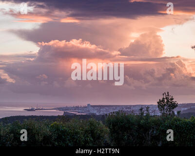 Storm Clouds above Ponta Delgada. High clouds move over the Azorian capital city and its harbour as the setting - Stock Photo