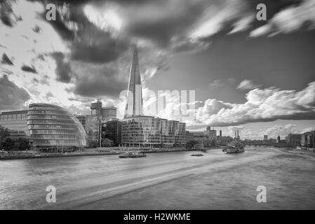 View of The Shard with City Hall and HMS Belfast from Tower Bridge in London - Stock Photo