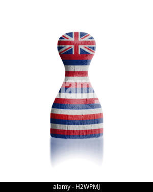 Wooden pawn with a flag painting - Stock Photo