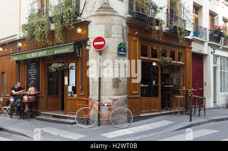 Paris, France-September 10, 2016: the traditional French cafe Au Bougnat set in a rustic bistro style, located near - Stock Photo