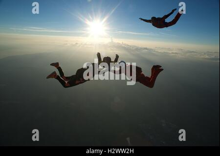 A skydiver closing in on a formation in freefall - Stock Photo