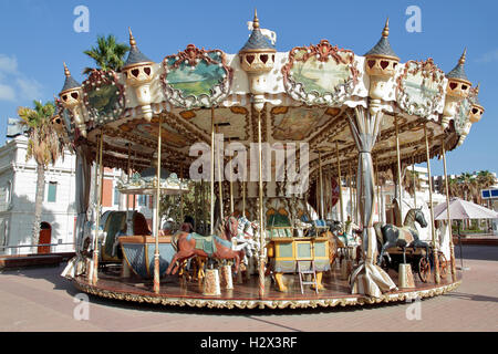 colorfull carousel installed on the street in the city of alicante, spain - Stock Photo