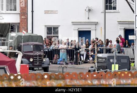Harry Styles and Tom Hardy fans wait in Weymouth, Dorset as they are due to be filming the war movie Dunkirk. Weymouth - Stock Photo