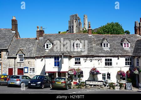 View of Corfe castle seen above The Greyhound Pub, Corfe, Dorset, England, UK, Western Europe. - Stock Photo