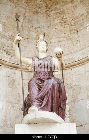 landmark statue of Minerva, Roman goddess of wisdom and sponsor of arts, trade and strategy, in public Campidoglio - Stock Photo